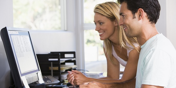 Employee and her husband using HR Technology at home to management their employee benefits