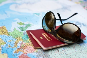 photo of passport, map, concept of traveling representing individual health insurance